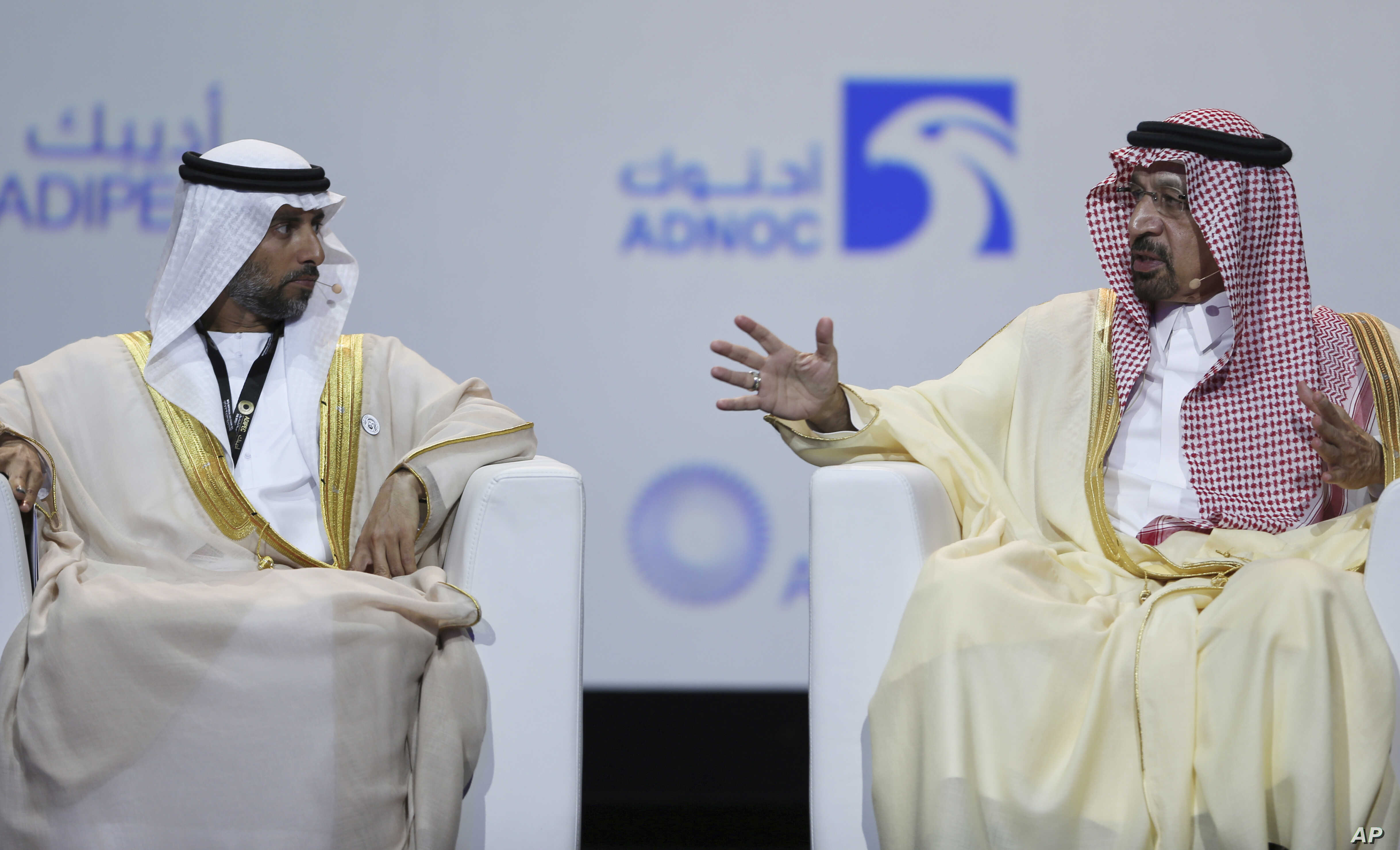 UAE Energy Minister Suhail al-Mazrouei, left, listens to Khalid al-Falih, Saudi Energy and Oil Minister, in the opening ceremony of the Abu Dhabi International Exhibition & Conference, ADIPEC, in Abu Dhabi, United Arab Emirates, Nov.12, 2018.