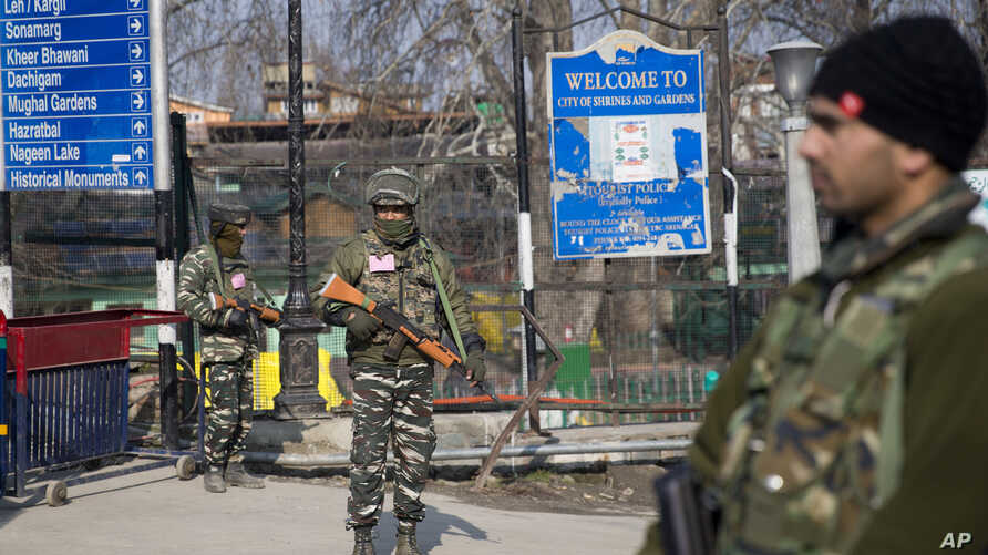 Indian paramilitary soldiers stand guard near a temporary check point during a strike in Srinagar, Indian controlled Kashmir, Feb. 3, 2019.