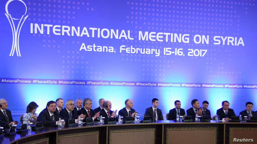 Participants of Syria peace talks attend a meeting in Astana, Kazakhstan, Feb. 16, 2017.