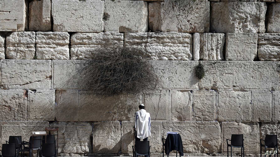 A Jewish man prays at the Western Wall, the most holy site where Jews can pray, in Jerusalem's Old City, Feb. 5, 2016.