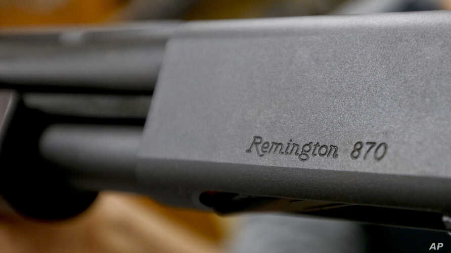 In this Thursday, March 1, 2018, photo The Remington name is seen etched on a model 870 shotgun at Duke's Sport Shop in New Castle, Pa.