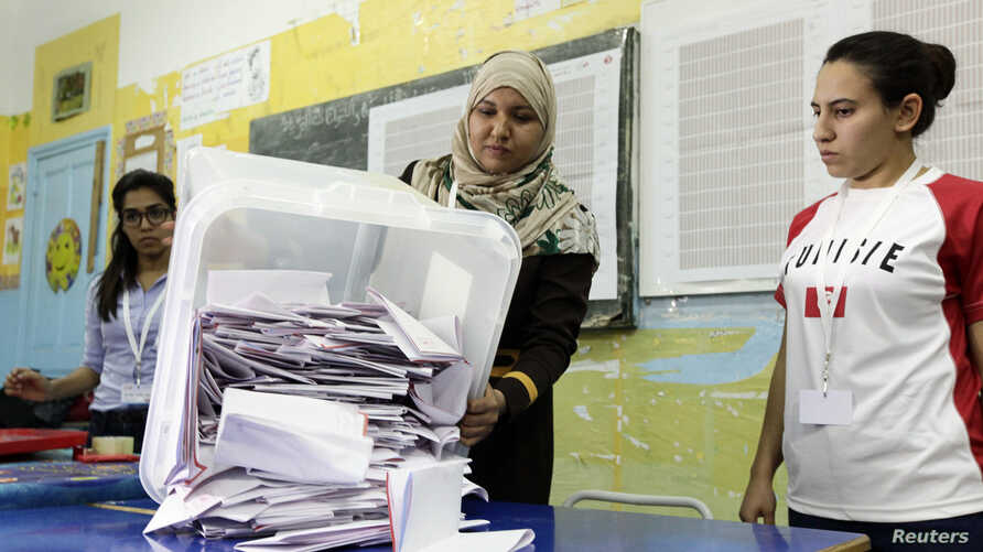 Election officials count ballots following Tunisia's parliamentary poll, in Tunis Oct. 26, 2014.