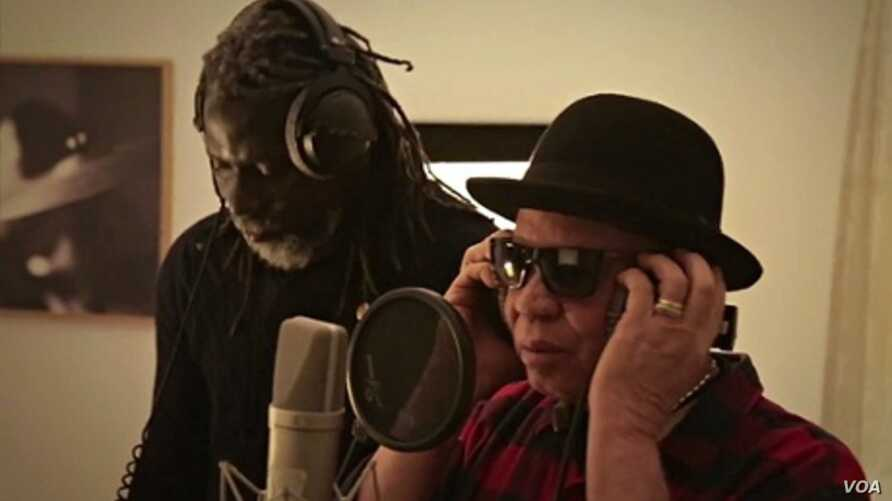 """Tiken Jah Fakoly and Salif Keita during recording of song/video, """"Africa Stop Ebola"""". Photo Credit: Remi Crepeau"""