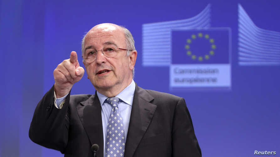 FILE - European Union Competition Commissioner Joaquin Almunia addresses a news conference at the EU Commission headquarters in Brussels.