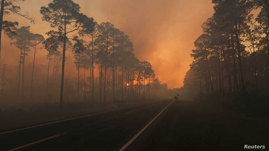 Smoke is seen during sunset as the West Mims fire burns in the Okefenokee National Wildlife Refuge, Georgia, in a photo released April 29, 2017.