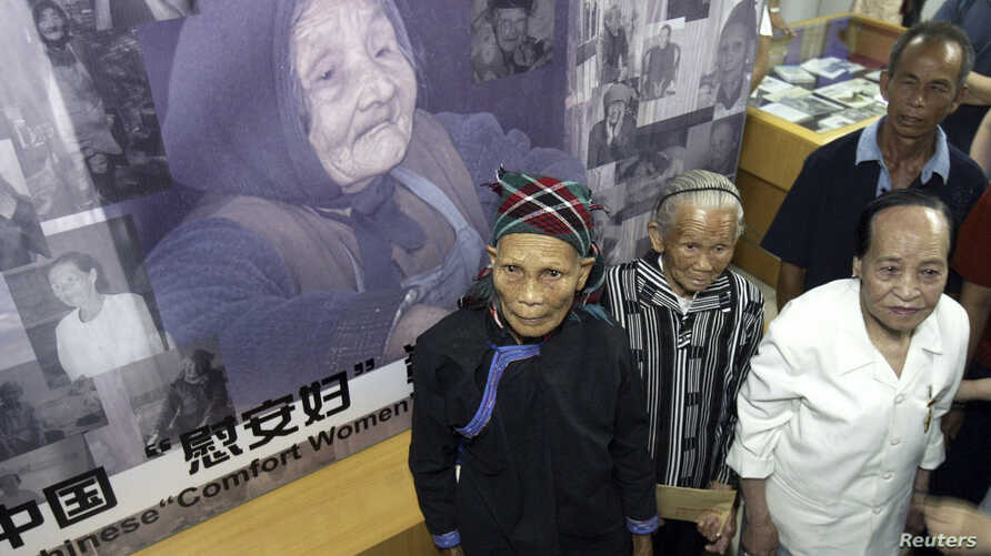 "FILE - Wan Aihua (front R) from Shanxi, Lin Yajin (front L) from Hainan, Wei Shaolan (front C) from Guangxi, who said they were forced to become comfort women by the Japanese military during World War II, attend the opening ceremony of the Chinese ""C"