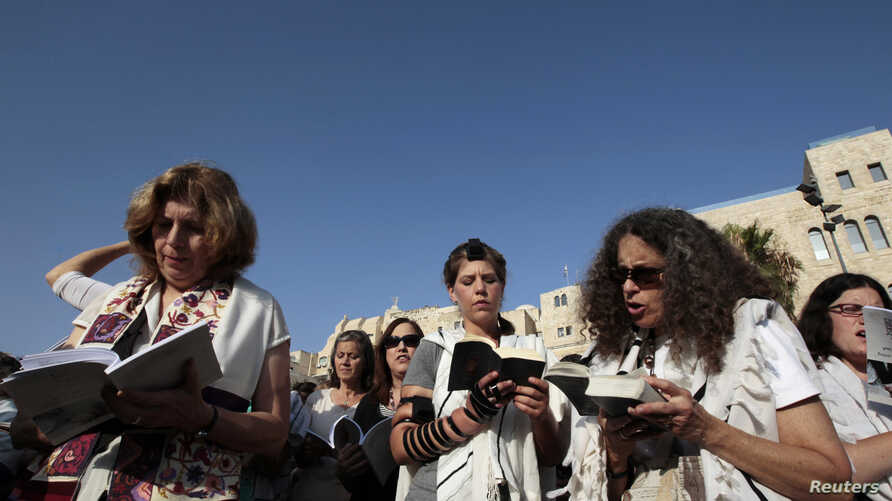 Jewish women activists, members of the Women of the Wall group, pray during a monthly prayer session at a spot a short distance from Western Wall plaza in Jerusalem's Old City, July 8, 2013.