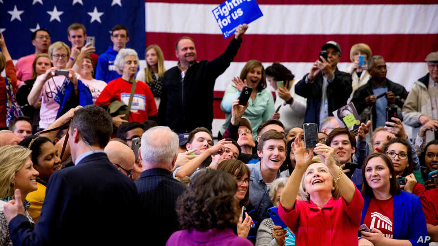 Democratic presidential candidate Hillary Clinton takes a group selfie after speaking at a get out the vote event at Transylvania University in Lexington, Ky., Monday, May 16, 2016.
