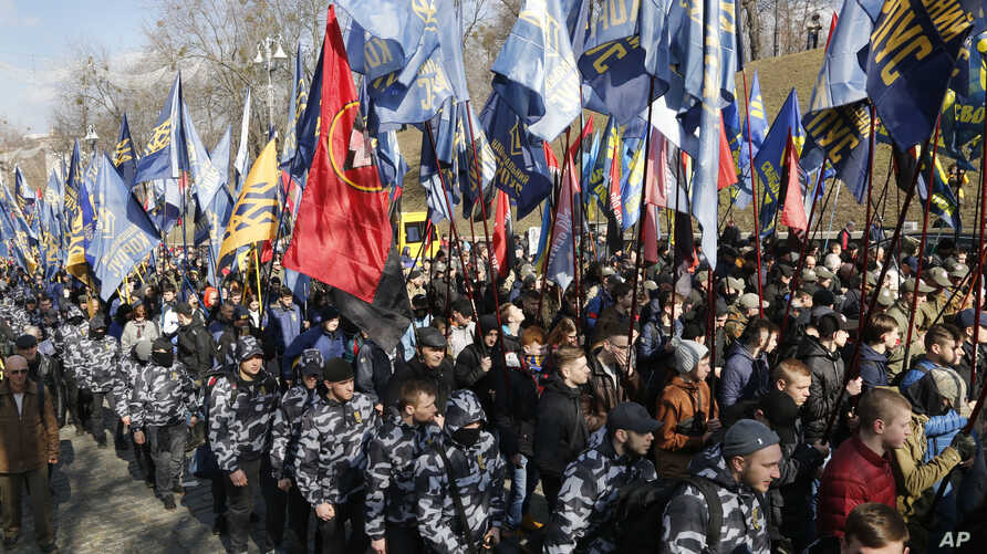 Ultra-right activists holds march during a rally against tycoons in national politics and economy in central Kiev, Ukraine, April 3, 2018.