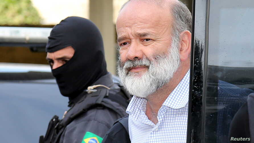 Joao Vaccari, treasurer of Brazil's ruling Workers' Party, is escorted by police after his arrival in Curitiba, April 15, 2015.