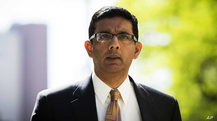 Dinesh D'Souza exits the Manhattan Federal Courthouse after pleading guilty in New York, May 20, 2014. D'Souza pleaded guilty to one criminal count of making illegal contributions in the names of others.