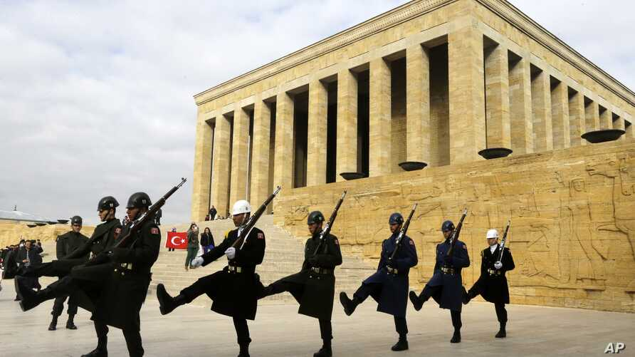 Soldiers march in front of the mausoleum of Mustafa Kemal Ataturk, the founder of modern Turkey, in Ankara on Thursday, Nov. 27, 2014.