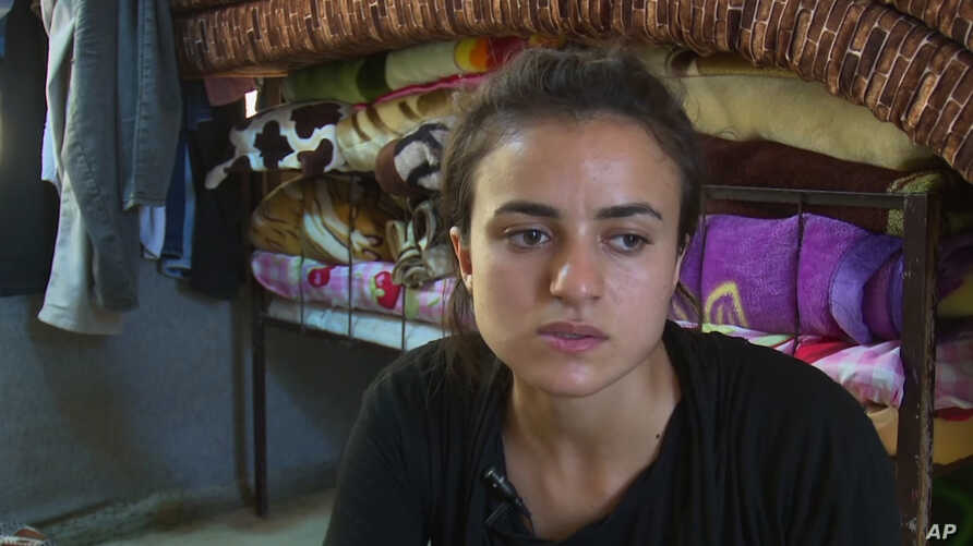 Yazidi refugee Ashwaq Haji Hami talks about her experiences in Germany, saying she has now returned to Iraq for fear that her alleged Islamic State tormentor could harm her in Germany, during an interview at Essian refugee camp, Aug. 17, 2018.