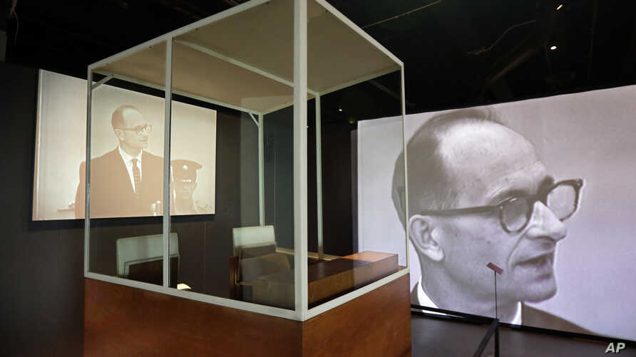 "The bulletproof glass booth in which Adolf Eichmann testified during his trial in Jerusalem District Court is displayed in the ""Operation Finale: The Capture & Trial of Adolf Eichmann"" exhibit at the Museum of Jewish Heritage in New York, July 14, 20"