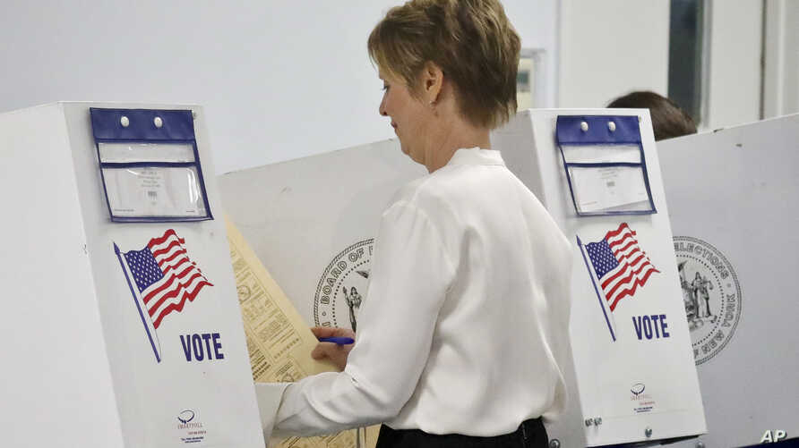New York gubernatorial candidate Cynthia Nixon prepares to vote in the primary, Sept. 13, 2018, in New York.