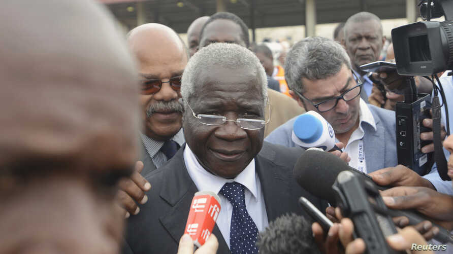 FILE - Renamo's Alfonso Dhlakama speaks to reporters after voting in general elections in Maputo, Mozambique, Oct. 15, 2014.