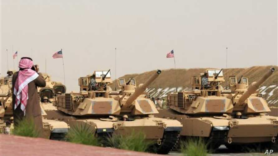 US Army heavy battle tanks are seen during the military parade commemorating the 20th anniversary of the liberation of Kuwait from the 1990 Iraqi invasion in Subiya, Kuwait, February 26, 2011