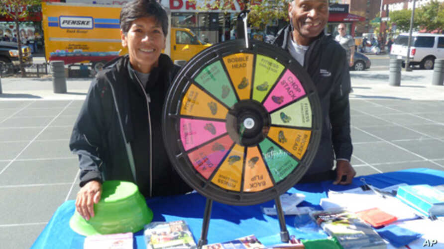 These vendors promote jogging and healthy eating during Wellness Week in New York's Harlem neighborhood.