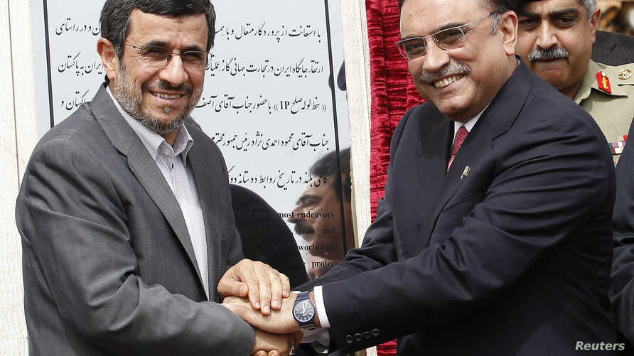 Iran's President Mahmoud Ahmadinejad (L) shakes hands with his Pakistani counterpart Asif Ali Zardari, during a groundbreaking ceremony to mark the start of construction of the Iran-Pakistan gas pipeline, in the city of Chahbahar in southeastern Iran