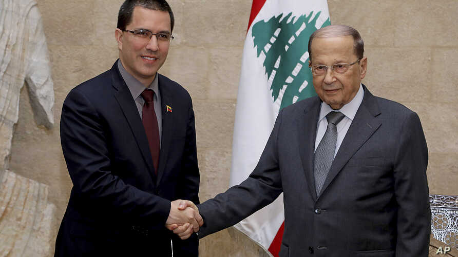 In this photo released by Lebanon's official government photographer, Dalati Nohra, Venezuelan Foreign Minister Jorge Arreaza shakes hands with his Lebanese counterpart, Gebran Bassil, in Beirut, Lebanon, Apr. 3, 2014.