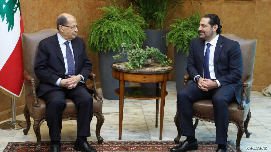Lebanese President Michel Aoun meets with Prime Minister Saad al-Hariri at the presidential palace in Baabda, Lebanon Nov. 27, 2017.