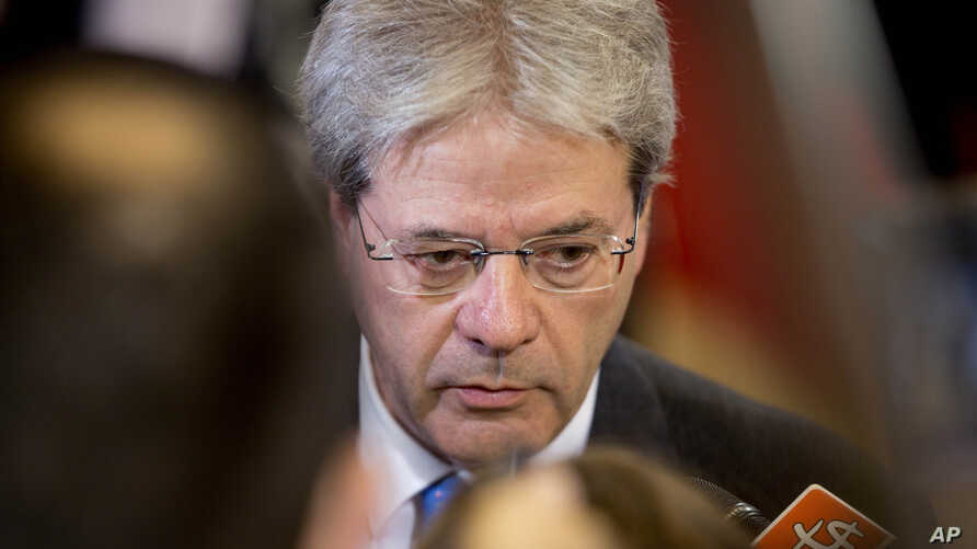 FILE - Italian Foreign Minister Paolo Gentiloni, shown at an EU foreign ministers meeting in Brussels in January, says 'the idea that there's an active terrorist threat only a few hours from Italy by boat' is unacceptable.