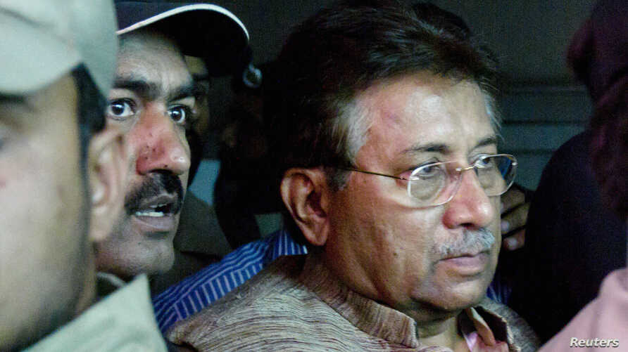 Pakistan's former president and head of the All Pakistan Muslim League (APML) political party Pervez Musharraf (R) is escorted by security officials as he leaves an anti-terrorism court in Islamabad, April 20, 2013.