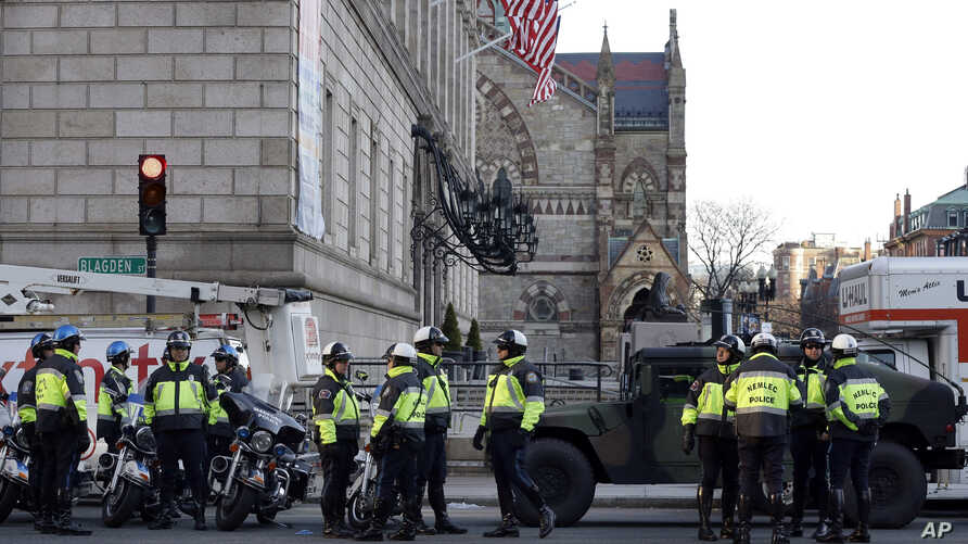 Boston police officers keep a perimeter secure in Boston's Copley Square as an investigation continues into the bomb blasts at the finish area of the Boston Marathon which killed 3 and injured over 140 people, April 16, 2013.
