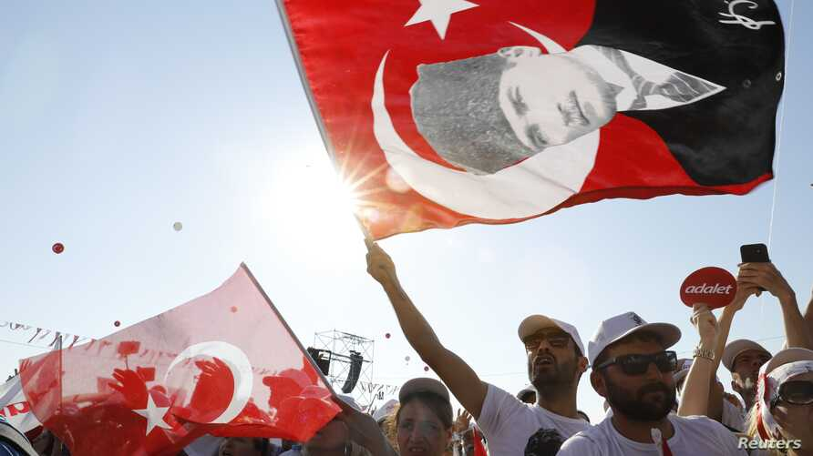 "People wave Turkish flags during a rally to mark the end of the main opposition Republican People's Party (CHP) leader Kemal Kilicdaroglu's 25-day long protest, dubbed ""Justice March"", against the detention of the party's lawmaker Enis Berberoglu, in"