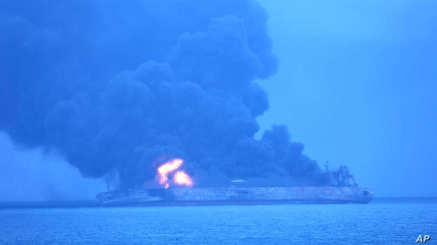"In this photo provided by Korea Coast Guard, the Panama-registered tanker ""Sanchi"" is seen ablaze after a collision with a Hong Kong-registered freighter off China's eastern coast, Jan. 7, 2018."
