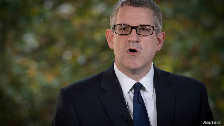 FILE - Director General of MI5 Andrew Parker delivers a speech in central London, on the security threat facing Britain, Oct.  17, 2017.
