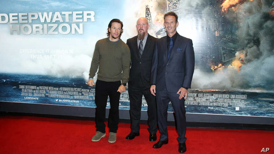 Director Peter Berg, from right, oil rig manager Mike Williams and actor Mark Wahlberg arrive at the premiere of the film 'Deepwater Horizon' in London, Monday, Sept. 26, 2016.
