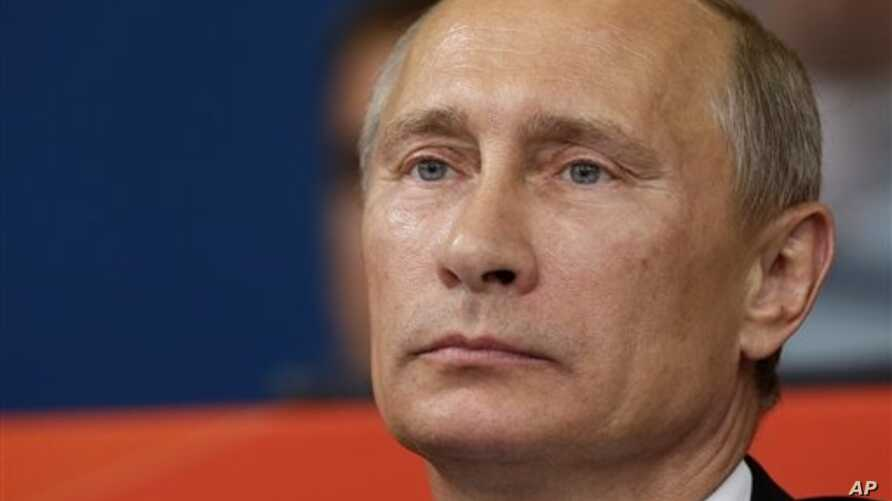 Russian President Vladmir Putin watches the judo competition at the 2012 Summer Olympics, London, Aug. 2, 2012.