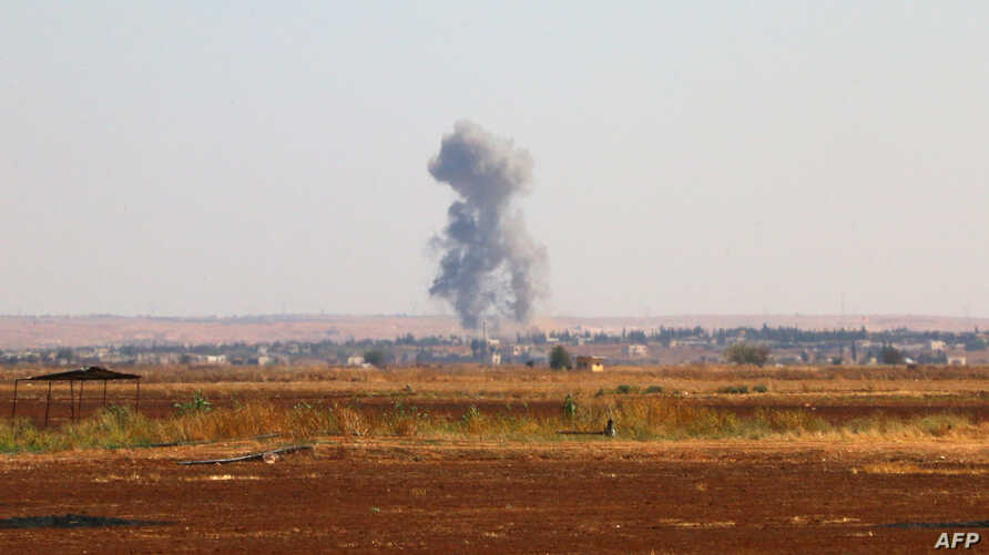 FILE - A picture taken Sept. 1, 2015 shows smoke billowing on the outskirts of Marea in the northern Syrian Aleppo district during fighting between opposition fighters and IS group.