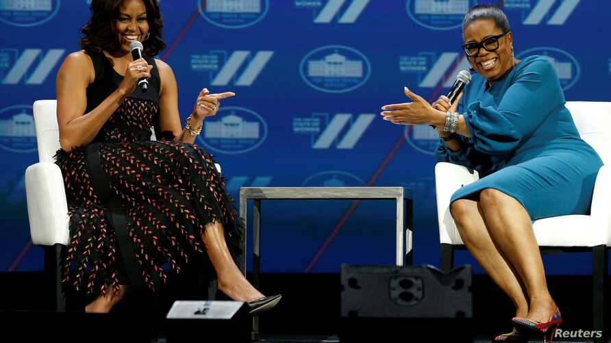"""U.S. first lady Michelle Obama and television presenter Oprah Winfrey participate in the White House's """"United State of Women"""" summit in Washington, June 14, 2016."""