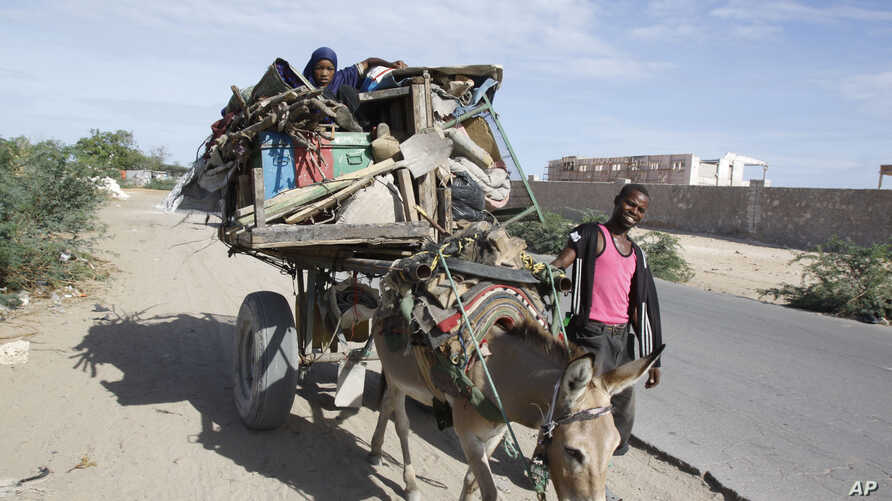 FILE - Somalis are seen leaving the Somali capital Mogadishu, due to hunger, for a refugee camp.
