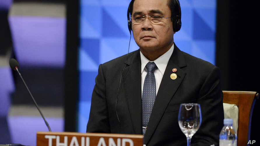 FILE - Thailand's Prime Minister Prayut Chan-o-cha listens to the opening remarks during the plenary session at the Asia-Pacific Economic Cooperation (APEC) Summit in Manila, Philippines, Nov. 19, 2015.