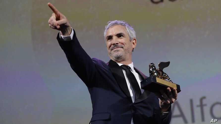 Director Alfonso Cuaron holds the Golden Lion Best Film award for 'Roma' at the closing ceremony of the 75th edition of the Venice Film Festival in Venice, Italy, Sept. 8, 2018.