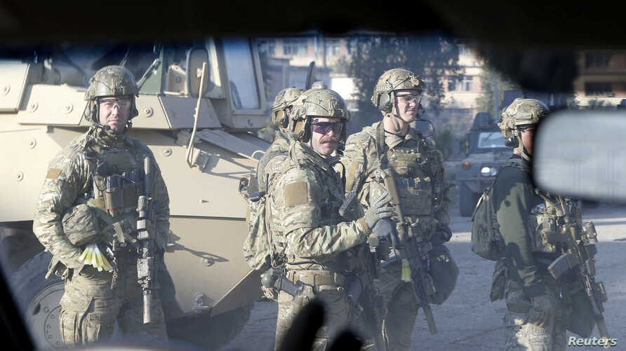 American army personnel gather at the University of Mosul during a battle with Islamic State militants in Mosul, Iraq, January 18, 2017.