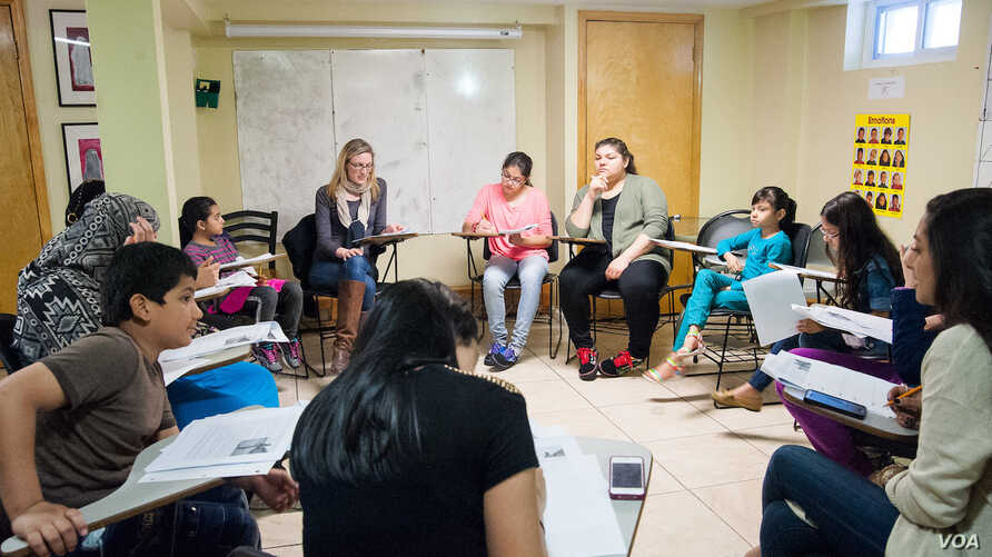 A discussion group at Women for Afghan Women headquarters in Queens, N.Y. (Credit: WAW)
