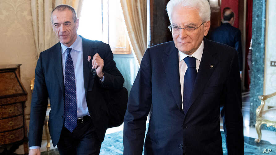 Former senior International Monetary Fund official Carlo Cottarelli arrives for a meeting with the Italian President Sergio Mattarella at the Quirinal Palace in Rome, Italy, May 29, 2018. I