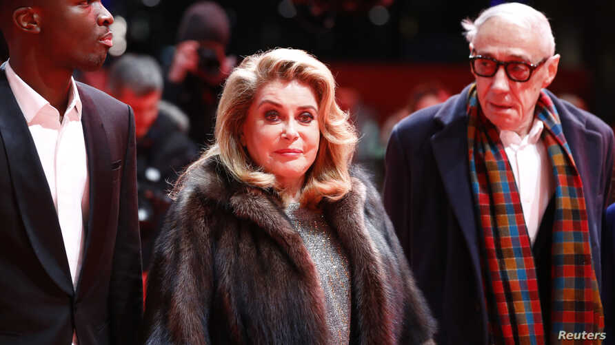 """Director and screenwriter Andre Techine and actors Catherine Deneuve and Stephane Bak arrive for the screening of the movie """"L' adieu a la nuit"""" (Farewell to the Night) at the 69th Berlinale International Film Festival in Berlin, Germany, Feb. 12, 20"""