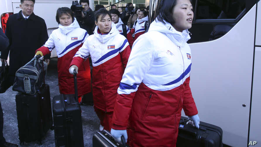 North Korean female hockey players arrive at the Inter-Korean Transit Office in Paju, South Korea, Thursday, Jan. 25, 2018.