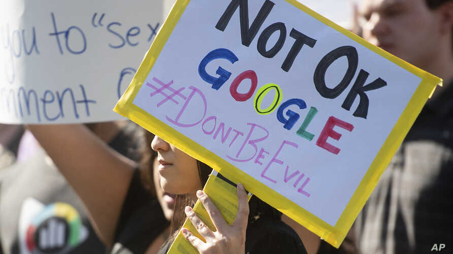 FILE- Workers protest against Google's handling of sexual misconduct allegations at the company's Mountain View, Calif., headquarters, Nov. 1, 2018.