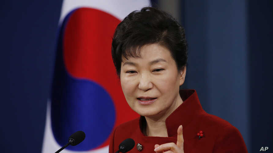 South Korean President Park Geun-hye answers to a reporter's question during her news conference at the Presidential Blue House in Seoul, South Korea, Wednesday, Jan. 13, 2016.