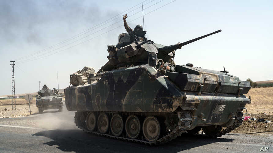 Turkish troops head to the Syrian border, in Karkamis, Turkey, Aug. 27, 2016. Turkey on Wednesday sent tanks across the border to help Syrian rebels retake the key Islamic State-held town of Jarablus and to contain the expansion of Syria's Kurds in a
