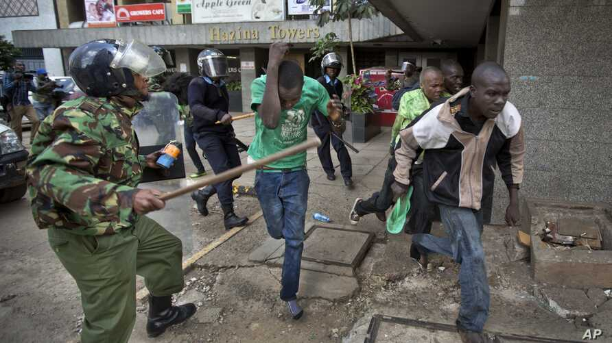 Opposition supporters are beaten with wooden clubs by riot police as they try to flee, during a protest in downtown Nairobi, Kenya, May 16, 2016.
