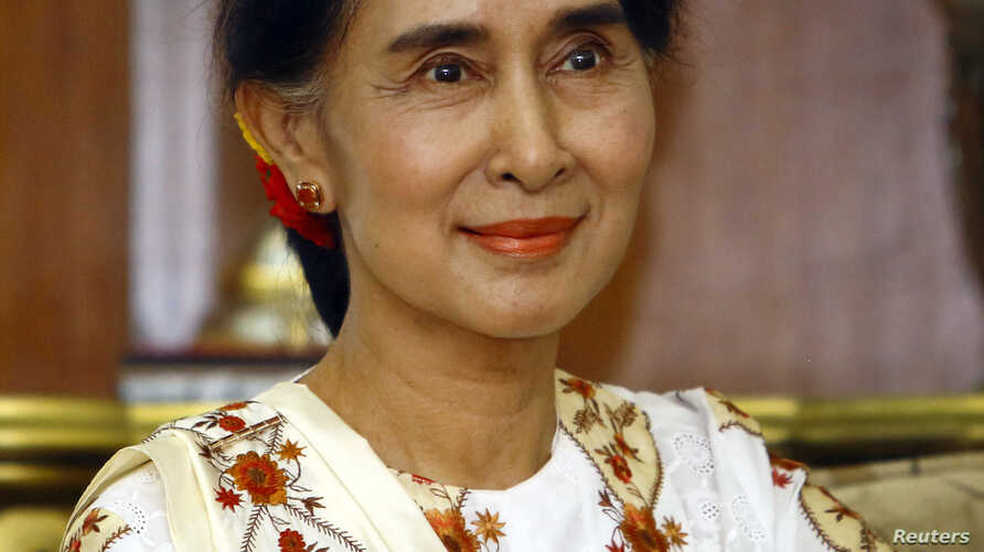 Myanmar's pro-democracy leader Aung San Suu Kyi is pictured during her meeting with Nepal's Prime Minister Sushil Koirala at his official residence in Kathmandu, June 13, 2014.