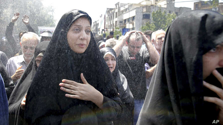 FILE - In this June 9, 2017, photo, Iranians attend the funeral of victims of an Islamic State militant attack in Tehran, Iran.