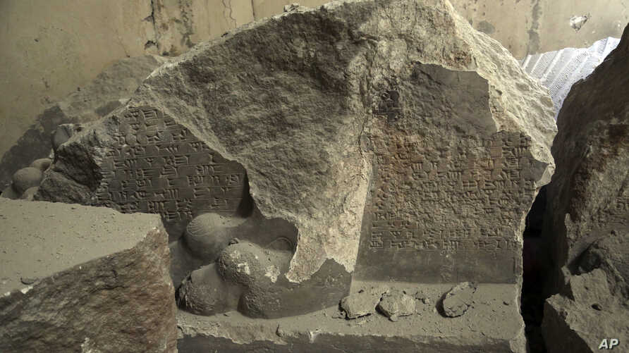 Ancient destroyed artifacts are seen inside Mosul's heavily damaged museum. Most of the artifacts inside the building appeared to be completely destroyed. The basement level that was the museum's library had been burned, in western Mosul, Iraq, March